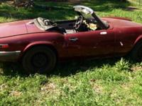 This is a traditional 1979 Triumph Spitfire. The body