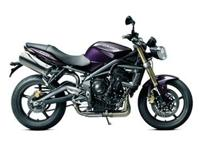 This 2012 Triumph Street Triple is a vibrant Imperial