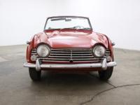 1966 Triumph TR4 A1966 Triumph TR4 A in red with black