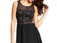 A lace bodice accented with metallic detail makes