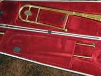 Trombone with case made in England. First $95.00 cash