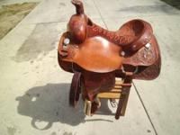 "This saddle has ""all-around champion cowboy"" 1983"
