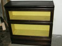 listing is for a antique book case [ trow bridge ].