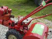 This troy built rototiller has a 6 HP Tecumseh. It's