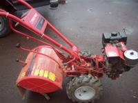 Troy Bilt pto horse tiller 7 hp briggs IC engine.