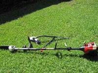 Troy bilt weedeater with saw, weedeater and edger