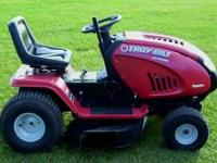 This is a Troy Bilt auto drive riding lawn mower with a