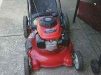 "21"" cut troybilt push mower with oversized rear wheels"