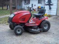 This is a troybuilt riding lawn mower with 21 hp v twin