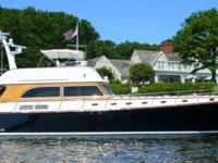 "Key Features ""TRUANT"". Perfection on the water. Top"