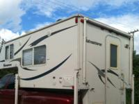 2011 Adventurer truck camper for sale. Queen bed, 10""
