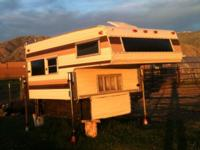 Short-bed truck camper includes; oven, stove, fridge,