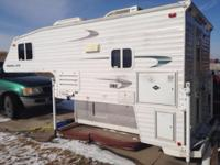 Great condition full-featured truck rv. Queen size bed
