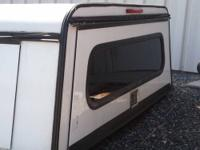 A white Contractor canopy for sale. Fits an 8ft. bed on