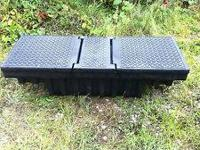 This is a plastic double door toolbox with slider tray.