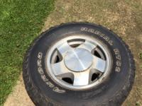 set of 4 LT 265/75R/16 tires on aluminum rims .Two