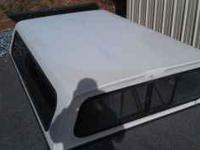 Fiberglass camper shell off of Ford pickup long bed.