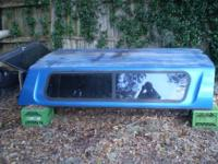 fiberglass truck topper in good condition with windows,