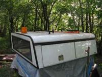 ARE Heavy Duty Aluminum Topper. Storage areas light up