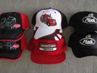 Six new trucker's caps. Two Peterbilt, two Mack, one