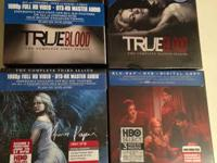 Seasons 1-4 of True Blood on Blu-Ray. Season 1 is open,