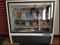 "Have a True brand refrigerated display case. 52"" tall"