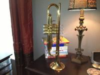 Sons trumpet used in High School. He graduated in 2008.