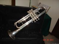 I have a very nice, unmarked silver trumpet w/case by