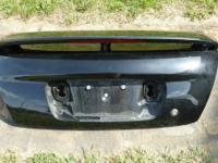 For sale is a black trunk with spoiler for a 2002 -2006