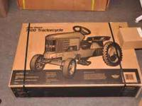 Riding pedal tractors, still in the box, 12 to 20 years