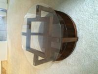 "like new round, three shelves,glass top, 40"" diameter"