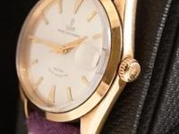 Offering a mint condition rare Tudor Oysterdate in 18K