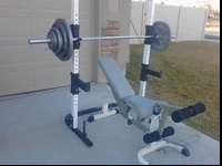 Tuff stuff Olympic squat rack and bench in great