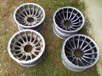 a set of 4 aluminum turbine style wheels. stamped