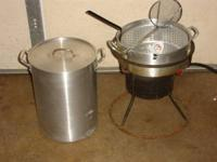 Propane gas cooker / Fryer. It has 2 pans one for fish