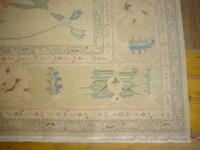 Hand knotted Turkish Antique replica rug is made of