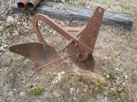 Turning plow that fits small Sears garden tractor,