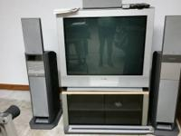 35 inch with 5 disc CD changer and speakers, works