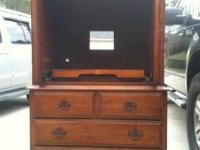 Chestnut stained TV armoire. Sturdy and good condition,