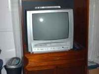 "Very nice, wood TV Amoire. It is 31"" wide, 19"" deep and"