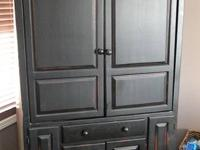 Selling our TV Armoire Entertainment Cabinet.  It is in