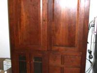 This is a TV Cabinet in Cherry wood which is a