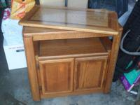 We are selling this light brown TV cart, that was used