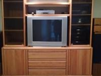 Solid oak entertainment center. Glass doors upper,