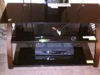 im moving so im selling my 3 shelf black glass swivel
