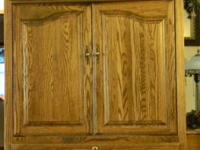 $175.00 Beautiful Oak TV Armoire with Etched Glass