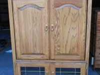 solid wood amish made armoire was used for a TV but