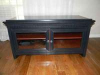 black tv stand with cherry shelves. like new, less than