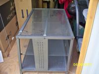 "Must Sell!! Glass TV stand...fits up to 42"" t.v. Asking"