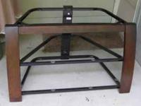 Sturdy TV stand with 3 smoked glass shelves, metal